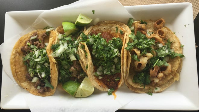 Paco's Tacos, right to left, tripa (tripe), chorizo (spicy sausage), suadero (beef) and asada (steak).