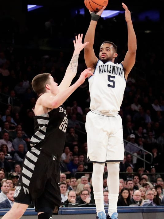 Villanova's Phil Booth (5) shoots over Butler's Sean McDermott (22) during the first half of an NCAA college basketball game in the Big East men's tournament semifinals Friday, March 9, 2018, in New York. (AP Photo/Frank Franklin II)