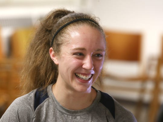 University of Rochester senior sprinter Laura Lockard laughs during a practice earlier this month.