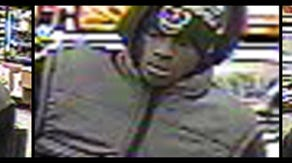Surveillance photos of a suspect in connection with a January robbery of a Speedway gas station.