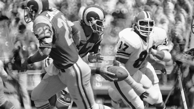 Atlanta Falcons defensive end Claude Humphrey closes in on Rams quarterback Joe Namath during a 1977 game in Atlanta. Humphrey sacked Namath on the play.