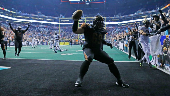 Rattlers offensive linesman Michael Huey (69) celebrates his touchdown in the 2nd quarter against the San Jose SaberCats in  their AFL National Conference final Sunday, Aug. 10, 2014 in Phoenix.