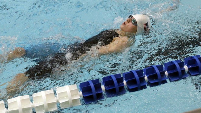 Emma Doughty, 11, of Hilton, swims in the 200-meter backstroke at the Deaf International Short Course Swimming Championships at RIT in Henrietta Friday evening.