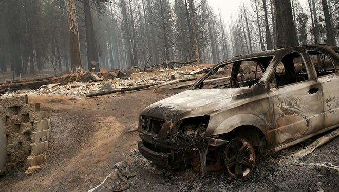 A burned-out truck sits in front of a structure that was destroyed by the King fire on Friday near Pollock Pines, Calif.