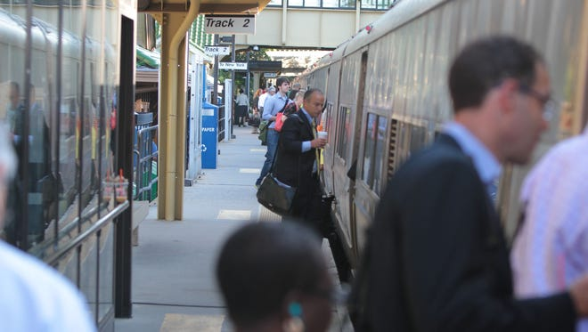 Commuters board a New York bound train at the Metro-North train station in Scarsdale in this file photo.