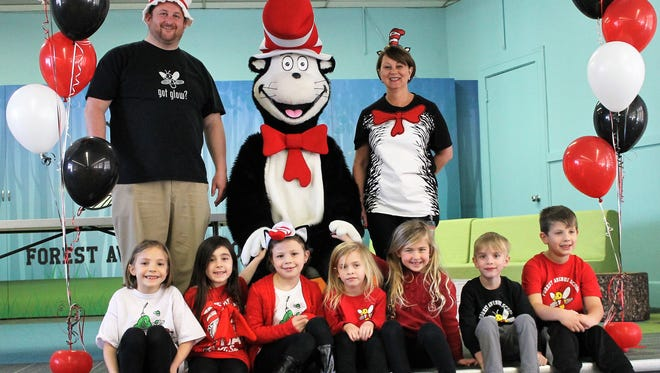 Forest Avenue School students and staff celebrate Dr. Seuss birthday. In the front row, from left: Calliope Conomos, Sadie Sweet, Lilly Renoff, Grace Arnett, Catherine Parseghian, Nolan Arnett and Noah Magalnick. In the back row, from left: Forest Avenue School Principal Matthew Murphy, The Cat in the Hat (a.k.a. Jennifer Loeb), and Forest Avenue School nurse Charlene Reilly.