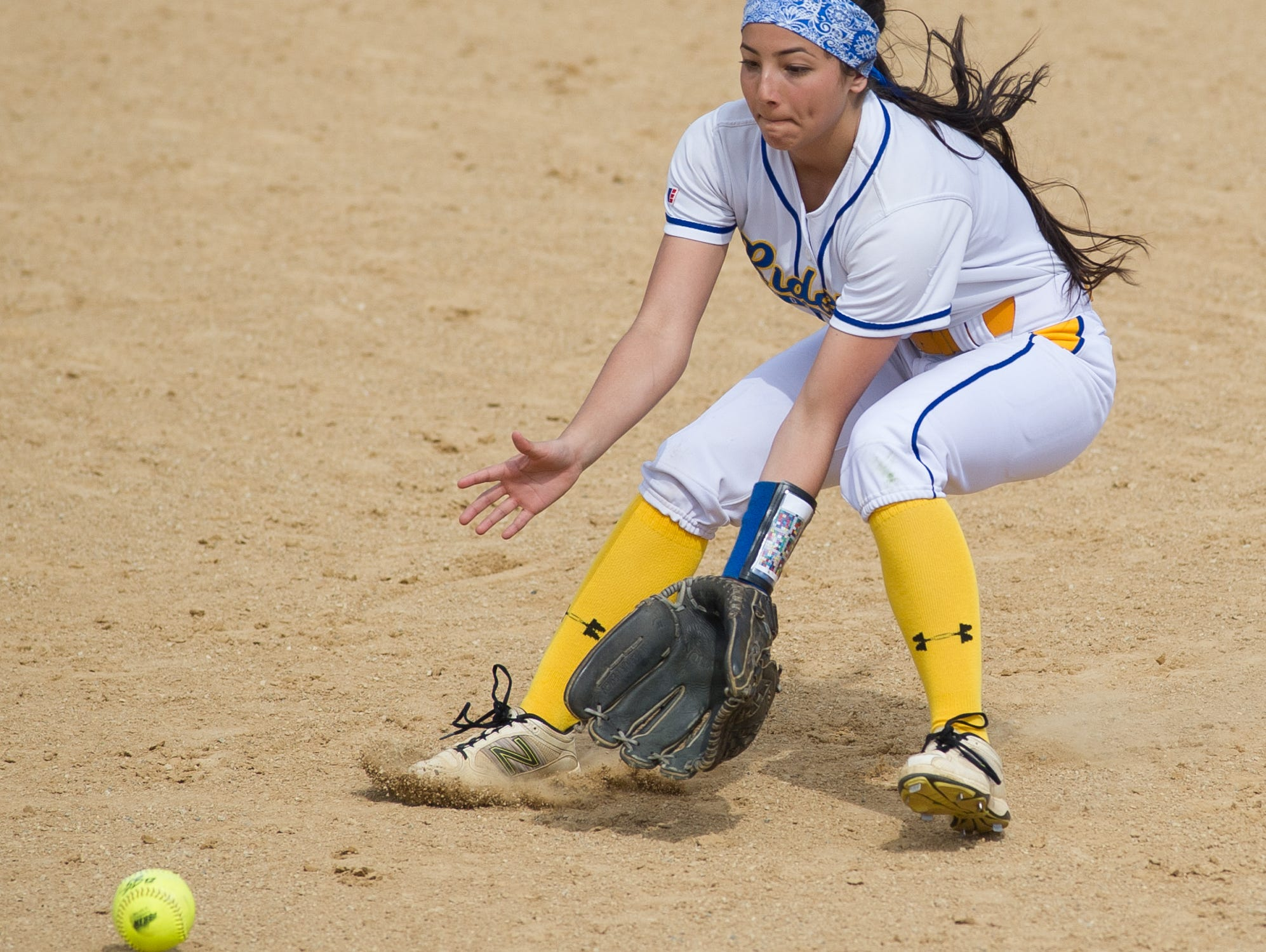 Caesar Rodney's Kendall Lewis (2) catches a ground ball in the 3rd inning against Concord.