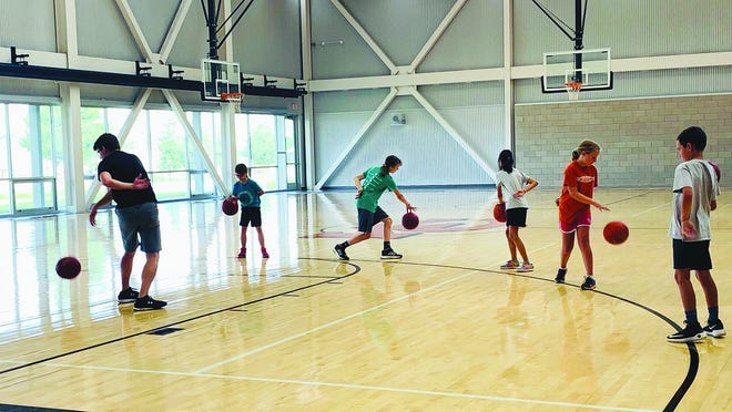 Kiowa County youth participate in a skills camp to help their young bodies get used to basketball type motions. (Starting second from left) Bristol Britton, Sayre Hassiepen, Jiwoo Chang, Amelia Barnes and Greyson Ballard work with Coach Thomas Derstein (left).