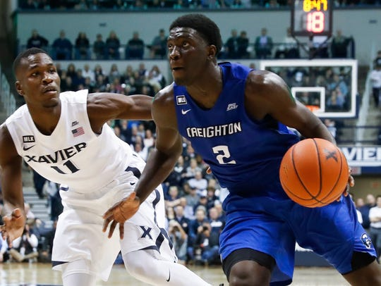 Creighton's Khyri Thomas (2) drives against Xavier's
