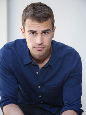 """Actor Theo James poses for a photo on March 8, 2014, in Beverly Hills, Calif.  The soulful Brit, the star of """"Divergent,"""" is being set up as Hollywood's next heartthrob."""