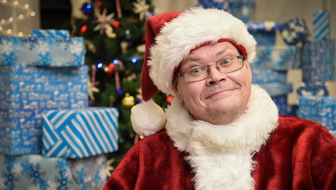 Jingle George, with an uncanny resemblance to PDN editor Duane George, is prepared for Christmas among his wrapped gifts on Dec. 21, 2016.