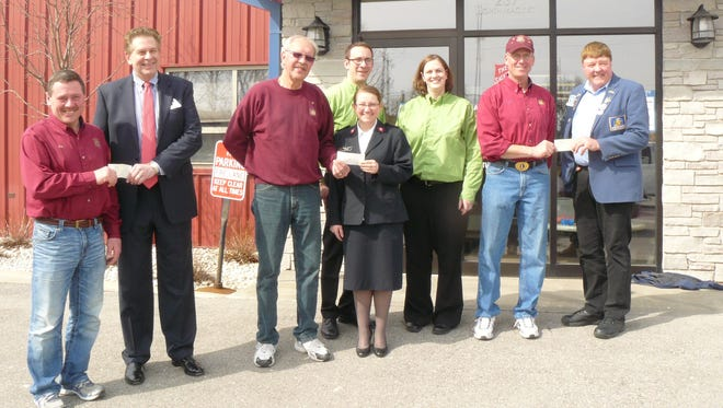 Pictured from left are: Joe Thome, St. Peter Lions Club; Dave Boelter, ARC of Fond du Lac executive director; Dave Miller, St. Peter Lions Club; Capt. Telinda Wilson, The Salvation Army; Matt Sullivan, Pick N' Save - Johnson St.; Amy Schneider, Pick N' Save - Pioneer Road; Larry Dikeman, St. Peter Lions Club and Fred Gebhardt, Wisconsin Lions Foundation.