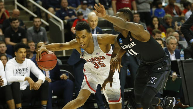 Arizona guard Allonzo Trier (35) drives against Xavier guard Malcolm Bernard (11) in the NCAA Tournament West Regional at SAP Center in San Jose, Calif., on March 23, 2017.