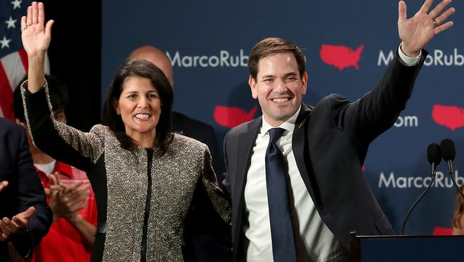 Marco Rubio (R) and South Carolina Gov. Nikki Haley (L) celebrate after Rubio addressed supporters at a primary night event February 20, 2016 in Columbia, South Carolina.