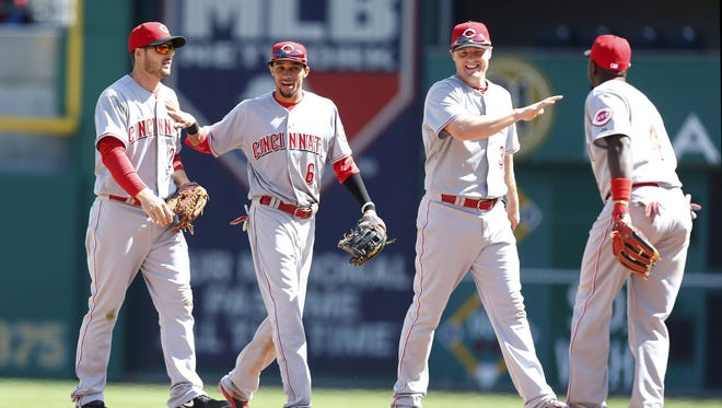 Chris Heisey (left), Billy Hamilton (6), Jay Bruce (right, center) and second baseman Brandon Phillips (right) celebrate after defeating the Pittsburgh Pirates at PNC Park.