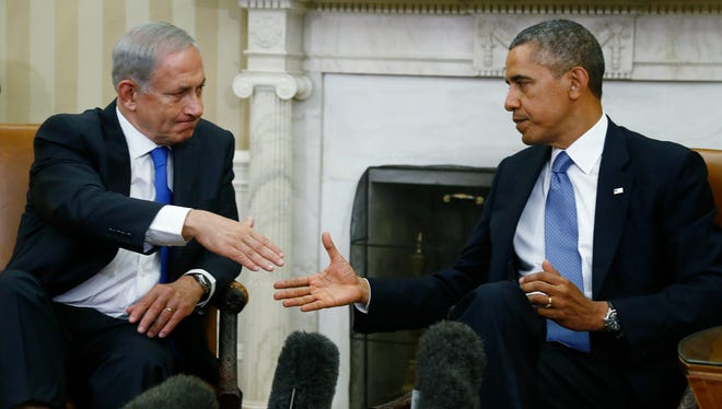 President Barack Obama and Israeli Prime Minister Benjamin Netanyahu shake hands after they made statements to reporters in the Oval Office at the White House in Washington on Monday.