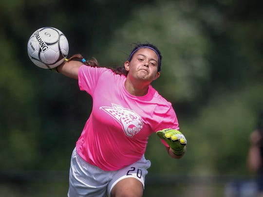 Ankeny Centennial senior goal keeper Marissa Lopez throws the ball into play against Ankeny during the Class 3A championship game of the 2018 Iowa girls high school state soccer tournament in Des Moines on Saturday, June 9.