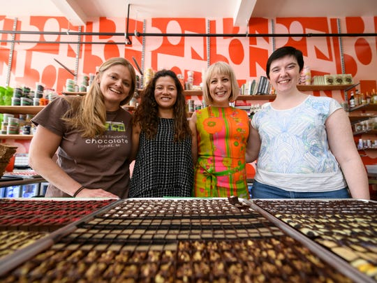 (From left) Jody Hayden, co-owner of Grocer's Daughter Chocolate, Jenny Samaniego, owner of Conexion chocolate, Alexandra Clark, owner of Bon Bon Bon, and Carla Martin, PhD, founder and Executive Director of the Fine Cacao & Chocolate Institute, pose for a portrait inside Bon Bon Bon, in Hamtramck, June 13, 2018. They will be panelists in a discussion about the politics and economy of chocolate.