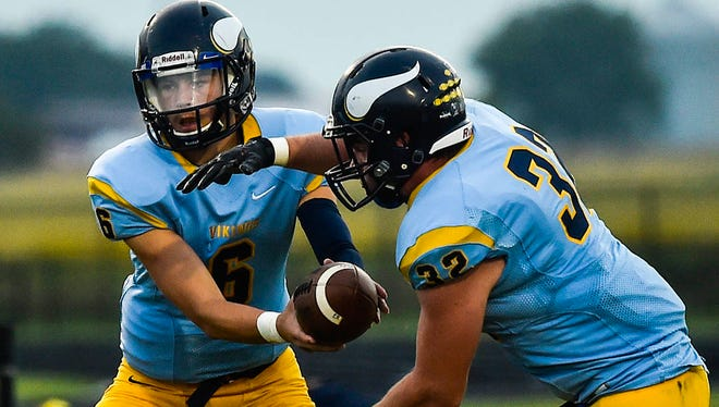 River Valley quarterback Josh Ellwood hands off to Zach Warwick in a game earlier this season. The Vikings host MOAC Red Division leaders Jonathan Alder on Friday night.