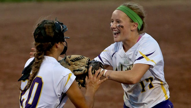 Johnston pitcher Haylee Towers, left, celebrated with Brooke Wilmes, right, after a 12-6 comeback win over Waukee in a Class 5-A state softball quarterfinal.