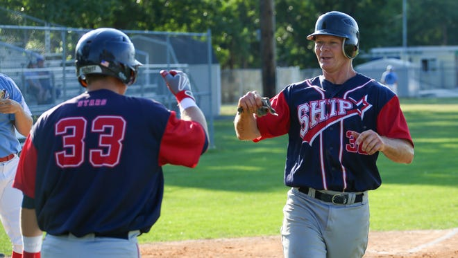 Shippensburg's Todd Melisauskas, right, fist bumps Andy Shreiner after scoring in a West Shore Twilight baseball game, Wednesday against Hagerstown. The Braves won 3-2.