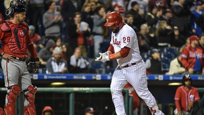 Philadelphia Phillies catcher Cameron Rupp (29) celebrates after hitting a home run in the eighth inning against the Washington Nationals at Citizens Bank Park. The Phillies won 17-3.