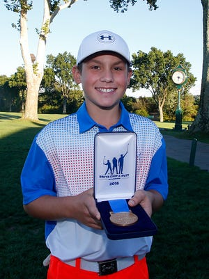 OAKMONT, PA - SEPTEMBER 11:  Boys 12-13 driving contest winner Luke Coyle poses for photos during the regional round of Drive, Chip and Putt Championship at Oakmont Country Club on September 11, 2016 in Oakmont, Pennsylvania.  (Photo by Justin K. Aller/Getty Images for DC&P Championship)