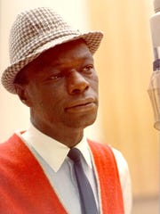 "Singer Nat ""King"" Cole records during a session in the Capitol Recording Studios in circa 1964 in Los Angeles, California."