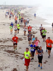Runners participate in Leg 1 of the 40th annual Beach to Bay Relay Marathon in 2015. The annual relay marathon is divided into six legs. The route stretches from Padre Island to McCaughan Park.