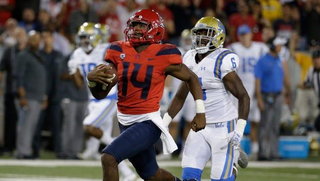 Arizona quarterback Khalil Tate runs for a touchdown against UCLA on Saturday, Oct. 14, 2017, in Tucson, Ariz. Arizona defeated UCLA 47-30.
