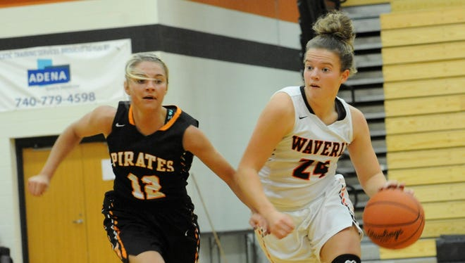 Waverly's Zoiee Smith drives to the hoop, past Wheelersburg's Ellie Ruby on Dec. 11, 2017 at Waverly High School. Smith leads the Tigers in points, rebounds, assists and steals per game.
