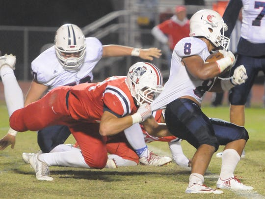 Oakland's Jackson Cauthen gets a hold of Cookeville's Blake Ashburn Friday.