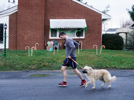 Charlie Jackson runs with his dog Forest during the