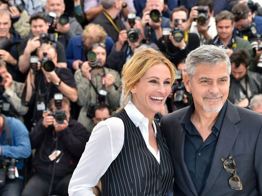 Julia Roberts and George Clooney pose for their Cannes Film Festival photo call.
