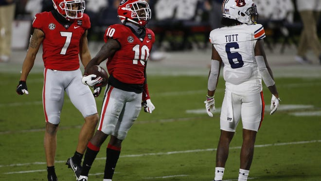 Georgia wide receiver Kearis Jackson (10) celebrates after making a catch during the first half of an NCAA college football game between Georgia and Auburn in Athens, Ga., on Saturday, Oct. 3, 2020.