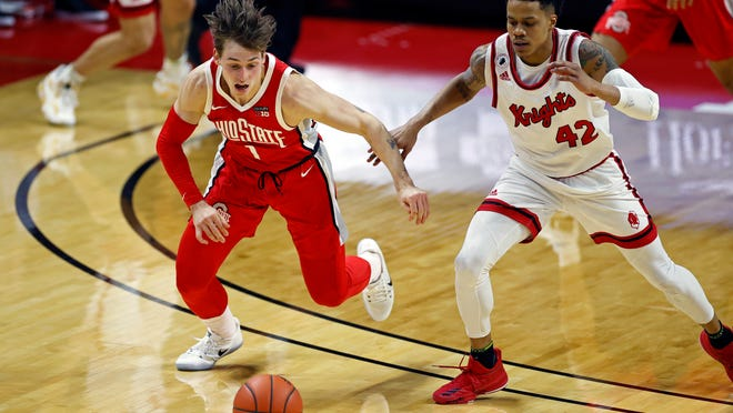 Ohio State guard Jimmy Sotos (1) chases a loose ball against Rutgers guard Jacob Young (42) during the first half of an NCAA college basketball game Saturday, Jan. 9, 2021, in Piscataway, N.J. (AP Photo/Adam Hunger)