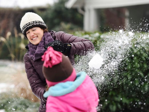Libby Carlson has a snowball fight with her children,