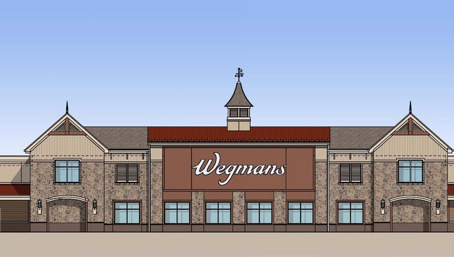"A rendering of what Wegmans will look like when opened. Company officials said Monday the store will open in ""early fall."""