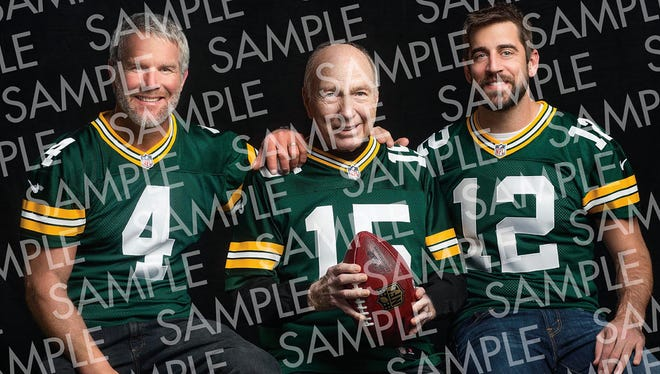 Brett Favre (4), Bart Starr (15) and Aaron Rodgers (12) pose for a photo before the Packers' Thanksgiving 2015 game against the Chicago Bears.