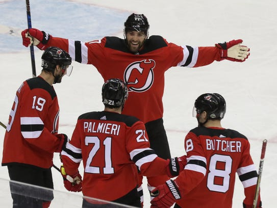 The Devils celebrate a first-period goal scored by