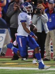 Cooper's Tyrees Whitfield runs 45 yards for the game's
