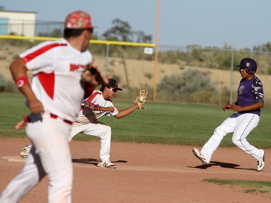 Naa'taanii's Dionte Yazzie records an out at second base after the Storm's Derek Curley attempted to steal on Tuesday at the Piedra Vista baseball field.
