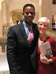 Camp Haven graduate Wil Harris with Sandra Robinson,