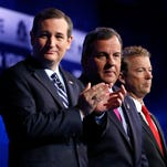 Ted Cruz, left, Chris Christie, center, and Rand Paul take the stage during the CNBC Republican presidential debate at the University of Colorado, Wednesday, Oct. 28, 2015, in Boulder, Colo. (AP Photo/Brennan Linsley)