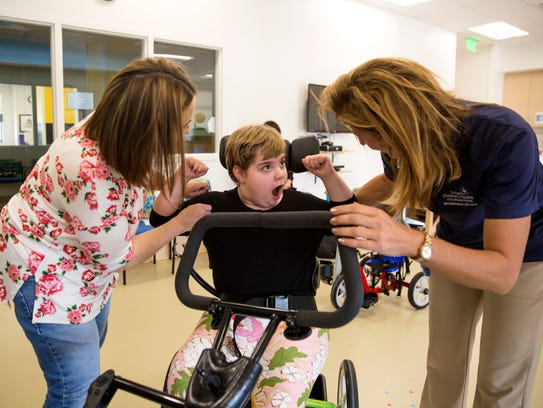 Samantha Garcia, 11, gets strapped into her adaptive