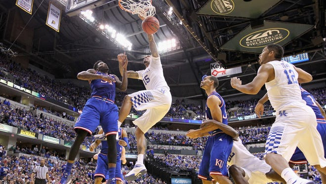 INDIANAPOLIS, IN - NOVEMBER 18:  Willie Cauley-Stein #12 of the Kentucky Wildcats dunks the ball during the game against the Kansas Jayhwaks in the State Farm Champions Classic at Bankers Life Fieldhouse on November 18, 2014 in Indianapolis, Indiana.  (Photo by Andy Lyons/Getty Images)