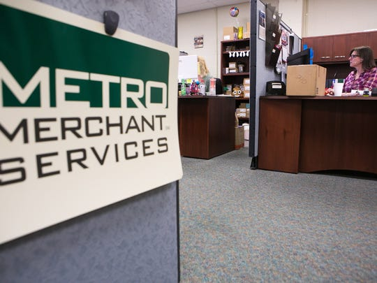 Customer Service Manager Sandi McCoombe helps a customer on the phone at Metro Merchant Services, the Delaware City-based electronic payment processing company founded in 1997.