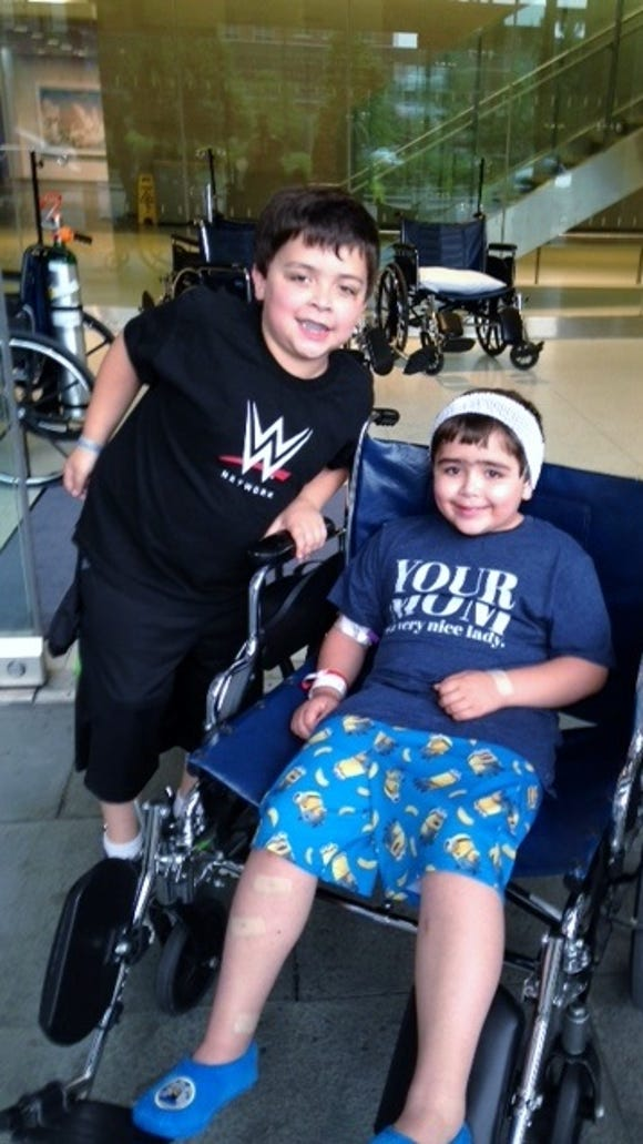 Seven-year-old Benny Homsher, right, and his nine-year-old