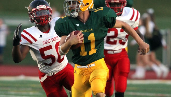 Morris Knolls Dylan Lesch gains yardage vs Morris Hills during their football matchup. September 11, 2015, Denville, NJ.