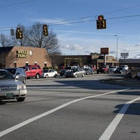 Traffic turns onto Woodruff Road from Miller Road.
